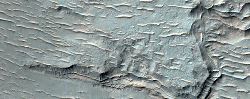 Light-Toned Outcrops in Holden Crater Secondary Southeast of Buta Crater
