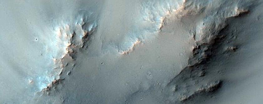 Impact Crater Exposing Bedrock