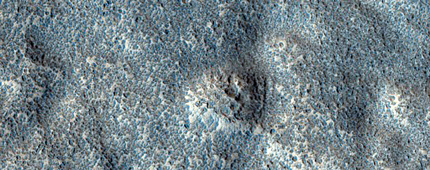 Crater with Mid-Latitude Textured Floor Seen in MOC Image E01-01805