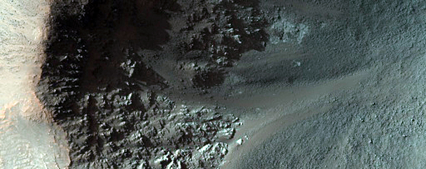 Crater Exposing Rocky Layers on Floor of Fournier Crater