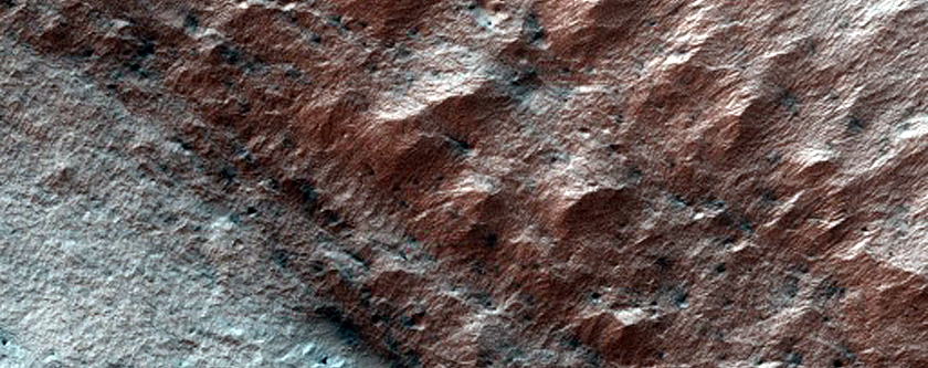 Active Dunes Underneath Broken-Off South Polar Layered Deposits Scarp