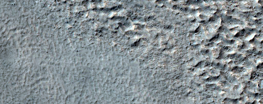 Dipping Layers in Crater in Southern Mid-Latitudes