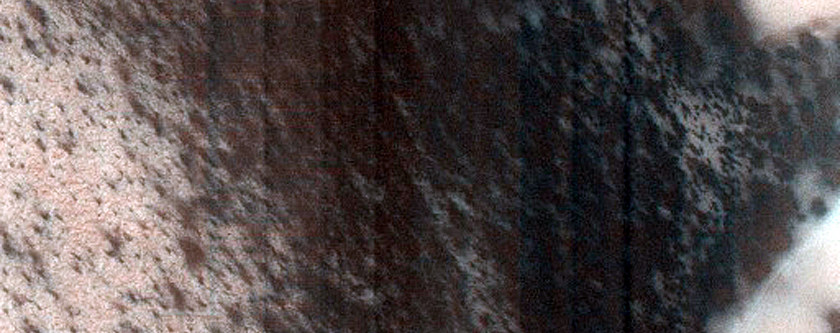 Layered Features Near Promethei Rupes