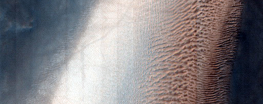 Dunes with Erosionally-Resistant Layers