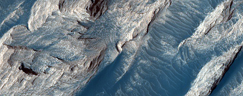 Formation Dubbed White Rock on Floor of Pollack Crater