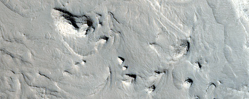 Layered Deposits Inside in Crater in Western Arabia Terra