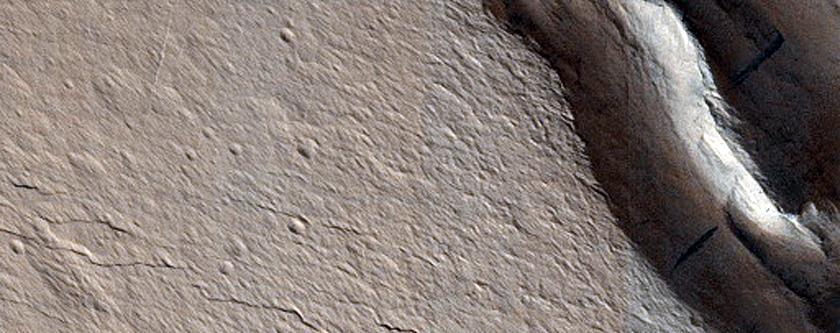 Cracks in Crater Deposit in Acheron Fossae