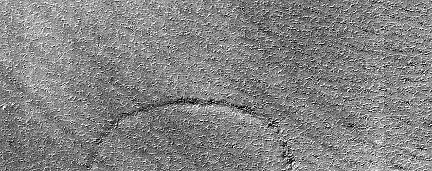 Possible 2-Kilometer Diameter Crater in South Polar Layered Deposits