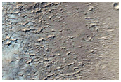 Een verweerde rotspunt in Apollinaris Patera