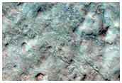Depósitos posiblemente asociados al cercano cráter Oudemans