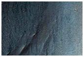 Suda muro de Coprates Chasma