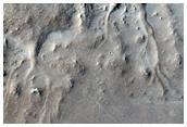 Ακτινικές κορυφογραμμές, ανάμεσα σε στρωματοποιημένα υλικά