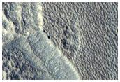 Um poço na Cratera Milankovic