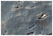 Depósitos estratificados en el cráter Crommelin