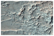Superficie con textura rugosa entre dunas oscuras