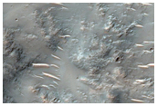 Phyllosilicates in the Ejecta of a Small Crater South of Isidis Planitia