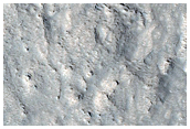 Crater on Mesa in Mamers Valles