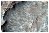 Layers Exposed in Pit on Crater Floor