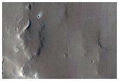 Butte and Mesa-Forming Materials in Central Arabia Terra