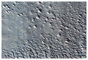 Flow of Material through Gap in Crater Rim in Phlegra Montes