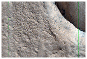 Layered Features in Craters along Hrad Vallis