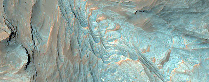 Layered Mineral Deposits on Floor of Cross Crater