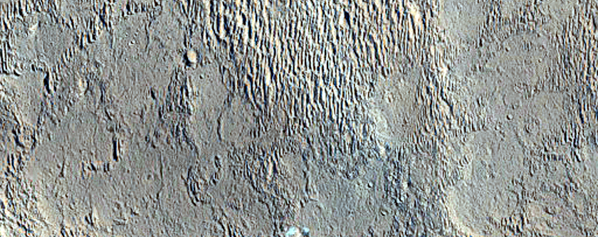 Possible Pitted Flow Emanating from Oudemans Crater