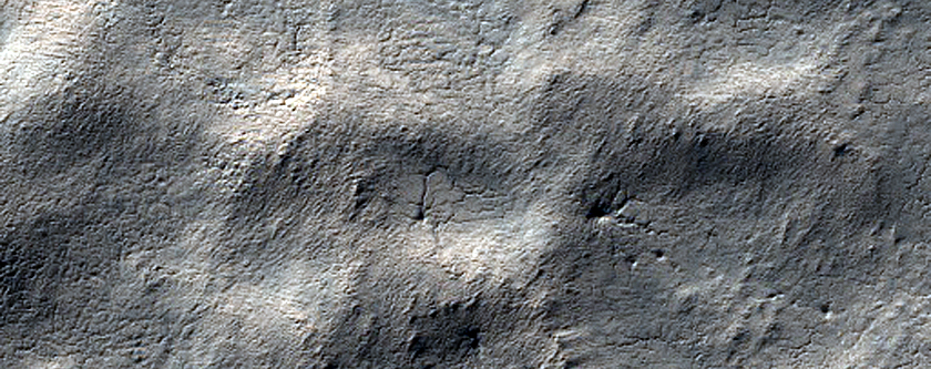 Possible Exposures of Polar Layered Deposits in Area Not Well Observed
