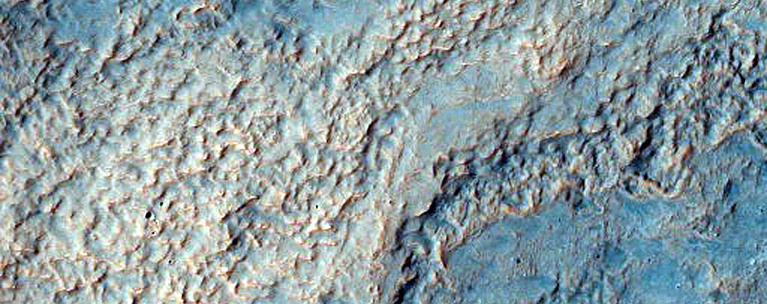 Diverse Layers and Morphologies in North Rim of Hellas Planitia