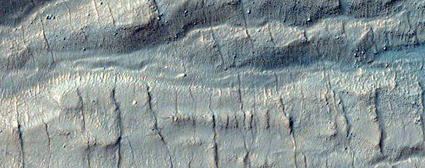 Monitor Steep Slopes of Asimov Crater