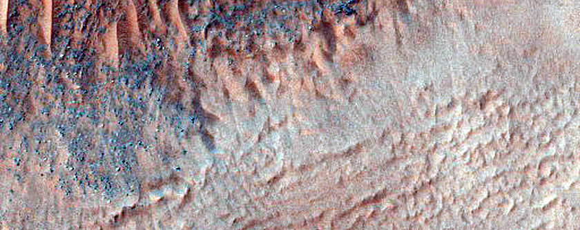 Central Structure of Impact Crater in Aonia Terra