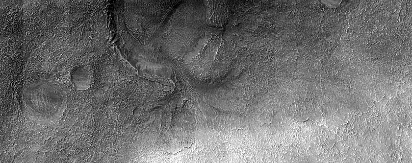 Crater with Breached Rim and Interior Terraced Landform