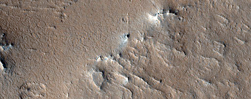 Valley-Channel Transitions in Crater in Arabia Terra