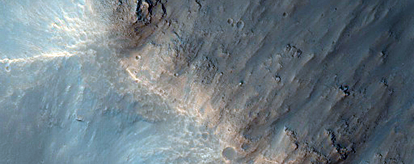 Possible Exit Breaches in Crater with Preserved Ejecta Texture