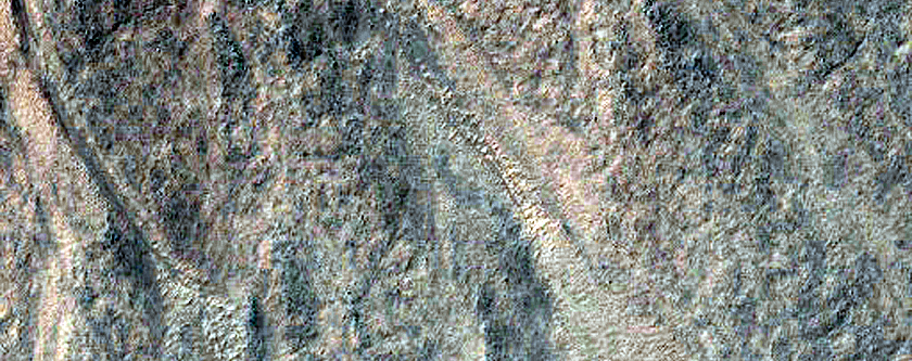 Gullies in Northwest Lowell Crater Wall Originating at Bouldery Deposit