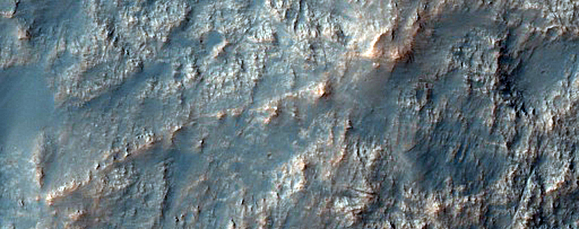 Possible Banded Olivine-Rich Massif in Northeast Hellas Planitia