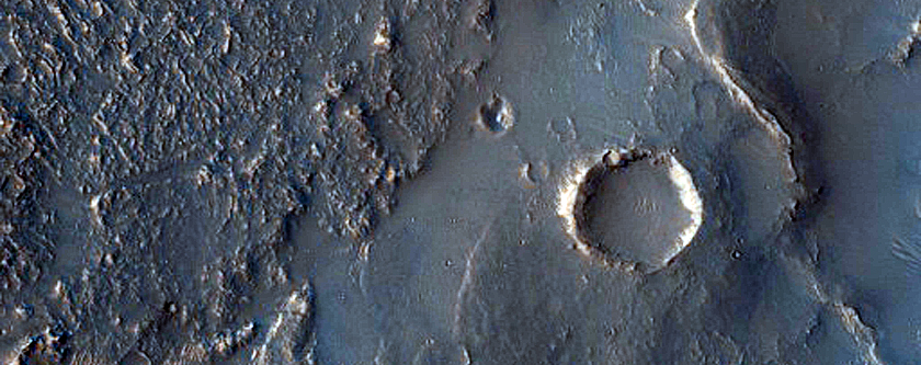 Terminus of Pitted Materials Emanating from Oudemans Crater