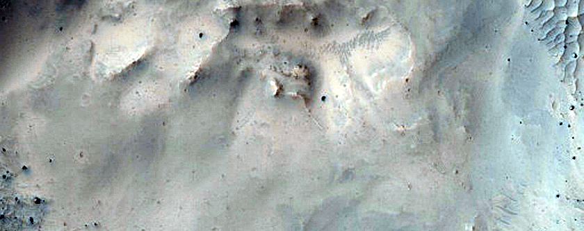 Crater with Exposed Layered Walls Superposed on Ejecta of Larger Crater
