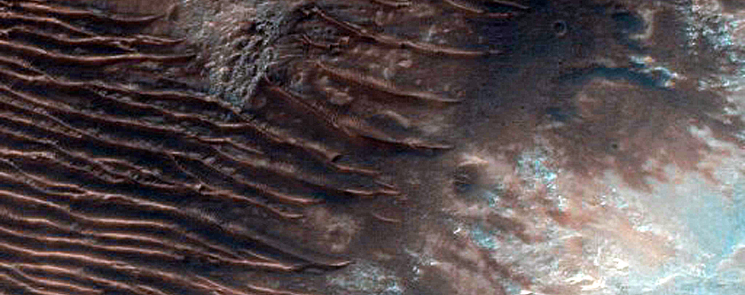 Small Outcrop of Light-Toned Possibly Layered Deposits in Ladon Valles