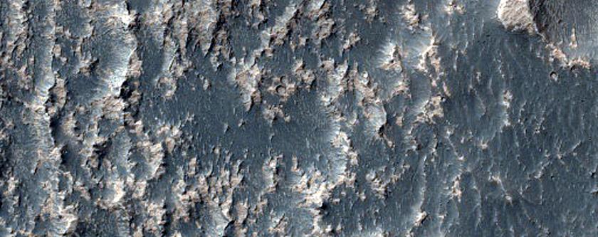 Unusual Erosional Texture Deposit High on Claritas Fossae