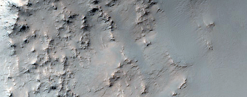 Possible Phyllosilicates in Crater Wall Near Mare Serpentis