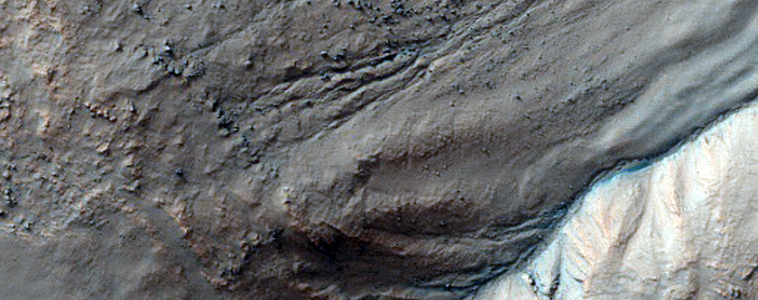 Gullies Initiating Mid-Slope within Mantle in Crater