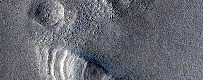 Layered Structure and Depression on Rim of Moreux Crater