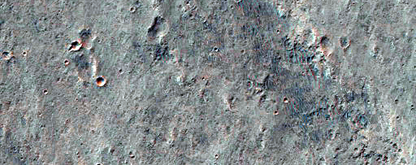 Mounds and Fractures in Eos Chasma