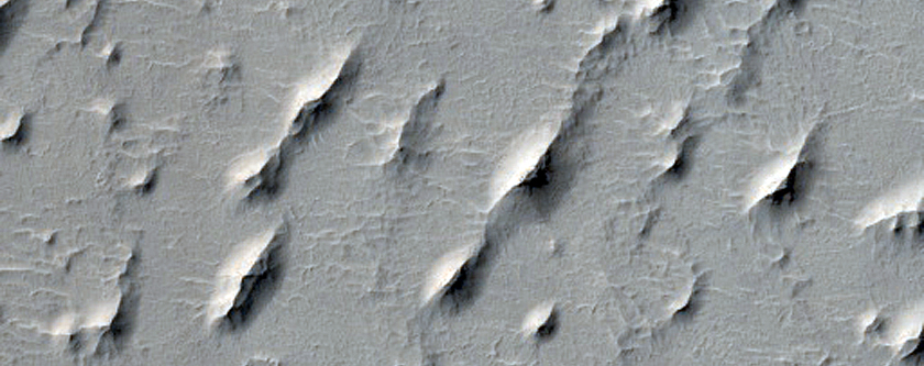 Intracrater Pits in Northern Arabia Terra