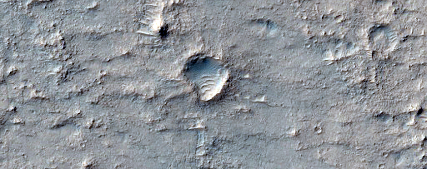 Small Sinuous Light-Toned Feature on Ridged Plain