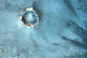 Fresh Crater with Dark Rays
