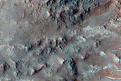 Eastern Portion of Well-Exposed 6-Kilometer Crater in Ladon Valles