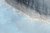 2-Kilometer Diameter Crater South of Ius Chasma
