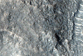 Crater with Butterfly Ejecta and Rocky Interior